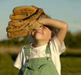 Child with baseball glove.