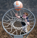 Boy shooting hoops in his front yard. (AP Photo/Rob Swanson)